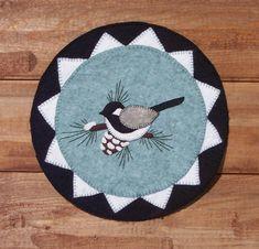 The First Snow Wool Applique Penny Mat Pattern. $9.00, via Etsy.