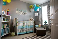 This gray nursery just screams 'boy' with the fun aqua and lime green pops of color!