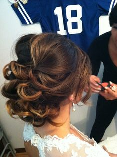 Most girls would notice the pretty hair, but I notice the Peyton Manning jersey hanging in the background! Haha!