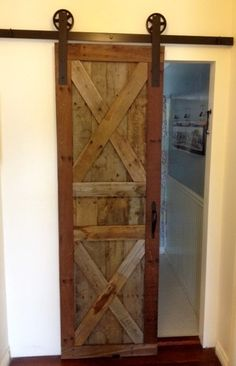 "27""w x 80""h pallet barn door created by Reconstruction Warehouse in San Diego, CA.   Contact them today for your own custom created door, indoor or outdoor furniture pieces, or wall coverings!   Or you can stop by and check out their inventory on reduced priced doors, counter tops, tiles and more!  http://www.recowarehouse.com/"
