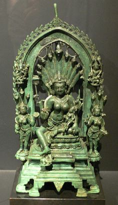 Manasa with Astika on her lap, 10th century Pala bronze from modern-day Bihar.