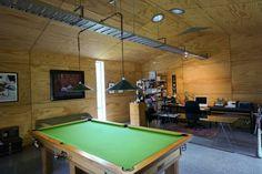 STUDIO SPACE: Bret de Thier's work area includes a billiard table.