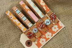 I use clothes pins for the open bags of chips and stuff.... pretty, decorated pins would be cuter~