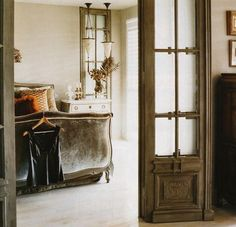 Old doors with frosted glass leading into the main room.