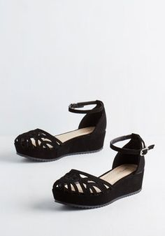 Another versatile shoe that would go with all the looks on this page, Flatform of Flattery Wedge in Black. ModCloth.