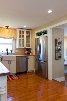 As seen on the HGTV series, House Hunters Renovation- love that the fridge is tucked into a cabinet and flush with the wall