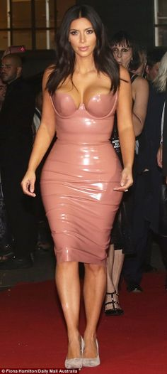 Peachy! Kim's rounded bottom was squeezed into the figure-hugging frock, which she proudly showed off on the red carpet