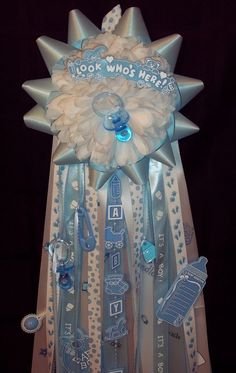 Cute idea to hang on door for decoration, but then she can take it to the hospital with her! It's a Boy Baby Shower Mum. $37.00, via Etsy.