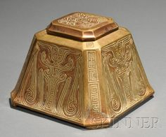 Large Tiffany Studios Chinese Pattern Inkwell   Bronze   New York, early 20th century   Four decorated sides with cut corners, hinged lid, glass liner, marked Tiffany Studios New York 1753, ht. 4 1/8 in.