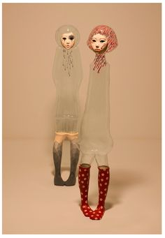 """jin young yu's transparent sculpture """"dolls""""-interesting, would like to know the procedure for making these. Are they made from bottles of glass, ceramics, etc.?"""