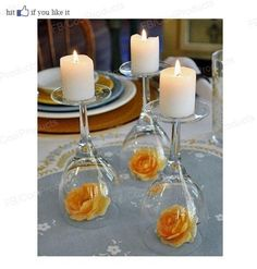 The next time I have a dinner party or am planning a shower, etc. I am going to use this ridiculously cheap and easy idea for centerpieces. Upside down wine glasses!