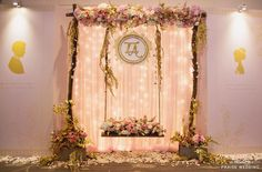 Magical fairytale-inspired wedding décor featuring a romantic swing surrounded by garden flowers!