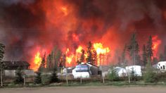 Raging forest fires whipped up by shifting winds sliced through the middle of Fort McMurray, Alta. on Tuesday, sending tens of thousands fleeing and prompting the evacuation of the entire city. Oil Sands, Fort Mcmurray, Wildland Firefighter, Beer Garden, Alberta Canada, The Guardian, Lightning, Around The Worlds, City