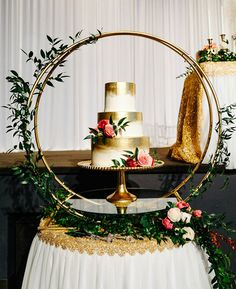 More Fabulous Wedding Cake Displays ~ cool gold circular structure make the cake the centerpiece