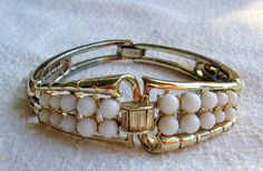 'Coro White and Gold tone hinged bracelet' is going up for auction at  7pm Sat, May 4 with a starting bid of $10.