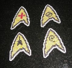 These are the rad cross-stitched Star Trek emblem magnets I made for the 80's craft swap.
