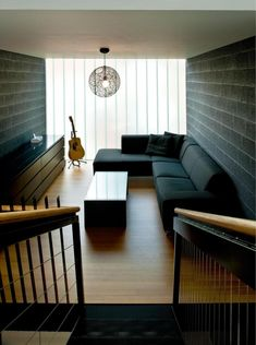 Black Sofa Color With Black Brick Wall And Wooden Floor For Narrow Living Room Layout For Your Ideas