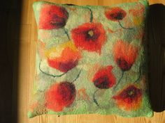 felted poppies on a mottled green ground - great inspiration for my felting machine