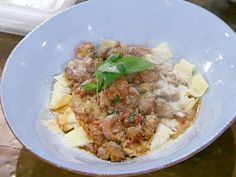 Get this all-star, easy-to-follow Food Network Pappardelle with Sweet and Hot Sausage Ragu recipe from Emeril Lagasse.