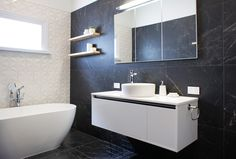Sarah & Minanne's Main Bathroom uses the gorgeous Bisazza Frozen Garden tile and also a beautiful marble replica porcelain tile called Marvel Pro Nero