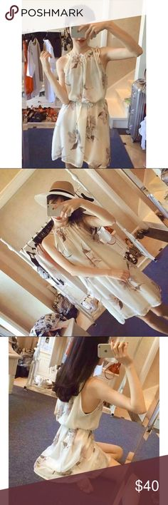 Dirty White Floral Print Halter Dress Floral pattern dresses can make you look beautiful. The fabric is 100% chiffon. It which comes with a separate string you can use to tie around the mid-section. Item is new with tags. Total Length 75cm, Bust 90cm. Dresses Mini