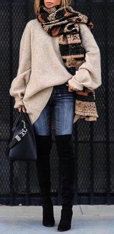 Oversized sweater, blue jeans, cute scarf and black OTK boots.