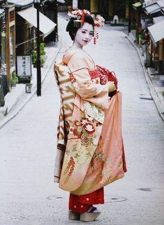 "Maiko /  Maiko is a jailbait before becoming a Geiko./ Maiko is own hair style hair./ ""Obimusubi"" is ""Darari"". / shoes of Maiko are 10cm-high ""Okobo"" / ""Maiko"" attaches a gorgeous ""Hana-Kanzashi"" to the hair, and the kimono is gorgeous."