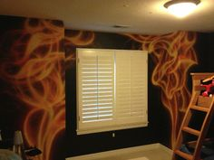 Airbrushed Realistic Flames in Boy's room.  This mural replaced the old nursery mural for the boy when he was a baby.http://www.ggodecorativ...