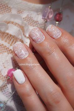 Delicate, pretty nails with filigree.