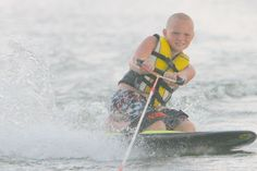 My son learning to knee board