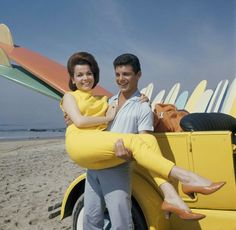 """Photo honoring Annette Funicello on Tributes.com. """"In this 1963 file photo, singer Frankie Avalon and actress Annette Funicello are seen on Malibu Beach during filming of """"Beach Party,"""" in California in 1963. Walt Disney Co. says, Monday, April 8, 2013, that former """"Mouseketeer"""" Funicello, also known for her beach movies with Avalon, has died at age 70."""""""