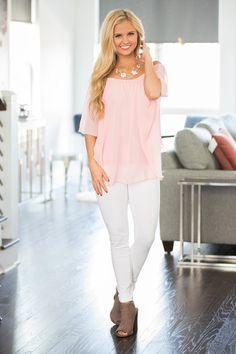 This adorable ruffled top is sure to add the perfect amount of romance to any occasion! We love the beautifully delicate look of this blouse - with the light pink color and sweet ruffled details, we c