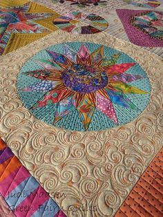 by Judi Madsen.  Gorgeous quilting