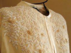 Vintage beaded sweater. 1950's hand beaded ivory lambs wool cardigan sweater with satin trim. Sz medium.. $98.00, via Etsy.