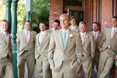 tan suits, mint tie for the groom, pink ties for the groomsmen // photo by Katelyn James Photography