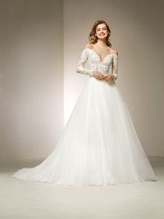 The off-the-shoulder neckline is just the beginning of this marvellous ballgown-style wedding dress.