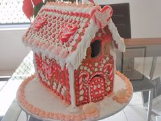 This is my first ever Gingerbread house. All decoration was don using Royal Icing. I also used miniature candy canes to make the love hearts.