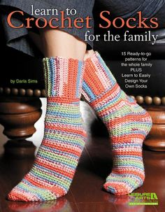 So comfy and soft, hand-crocheted socks are one of life's ultimate luxuries! Crochet expert Darla Sims presents 15 cozy toe-warmers for the family and also teaches you how to design your own. There are socks and slipper socks for children, women, and men. From anklets to add-on ribbing socks, top-down socks to sports socks, the varying styles offer something to please everyone. @Misty Prasad