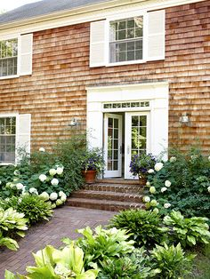 A shake-shingle house is a classic architectural style, one that often reflects attention to balance and understated materials. http://www.bhg.com/home-improvement/door/exterior/exterior-door-ideas/?socsrc=bhgpin052114symmetry&page=10