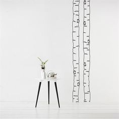 Decorate your room with nordic birches in a scandinavian style - beautiful wall decoration from danish Ferm Living.