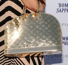 Just a dream of mine....I have always loved this mettalic Louis Vuitton bag.
