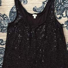 J. Crew Sequin Black Tank Top J. Crew black tank top with sequin. Perfect for dressing up a casual outfit or adding some flair to your office wardrobe. Lovely shirt! J. Crew Tops Tank Tops