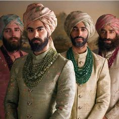 Mens wear by Sabyasachi Mukherjee. The men wear pale hand-embroidered raw silk sherwanis and hand-printed organza safas in water colour hues. Their necks are lavishly adorned with Zambian and Russian. Sherwani For Men Wedding, Wedding Dresses Men Indian, Groom Wedding Dress, Sherwani Groom, Wedding Suits, Wedding Wear, Vogue Wedding, Mens Indian Wear, Mens Ethnic Wear
