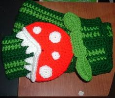 Nanette Crochet: Piranha Plant scarf and hat set with pattern! Super easy I only made the scarf but the set would be cool for a kids gift! Crochet Scarves, Crochet Yarn, Crochet Clothes, Free Crochet, Crocheted Scarf, Crochet Geek, Irish Crochet, Knitted Hats, Mario Crochet