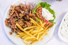 Learn how to make and prepare the recipe for Greek style gyro plates. Santorini, Falafel Sandwich, Pita Wrap, Greek Dinners, Greek Gyros, Greece Food, Gyro Recipe, Chicken Gyros, Seafood Dishes