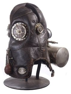 Shop scientific instruments and other antique and vintage collectibles from the world's best furniture dealers. Steampunk Armor, Full Face Helmets, Museum Collection, Vintage Posters, Aviation, Masks, Lion Sculpture, Europe, Tech