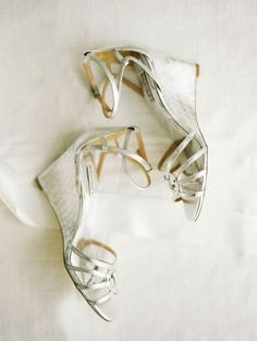 Strapy Silver Wedding Shoes: http://www.stylemepretty.com/2015/06/11/20-chic-shoes-that-wont-sink-in-the-grass/