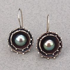 jewelry image of Galaxy style earrings set with raven's wing freshwater pearls.