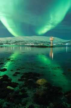 Northern light (aurora borealis) in Tromsø, Norway.I want to go see this place one day.Please check out my website thanks. www.photopix.co.nz