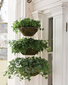 Too many houseplants and not enough floor space? This tiered basket allows you to display three of them in a single corner.